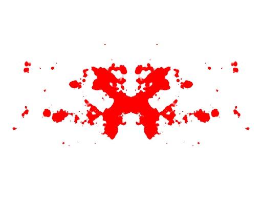 Symmetrinen punainen musteläiskä